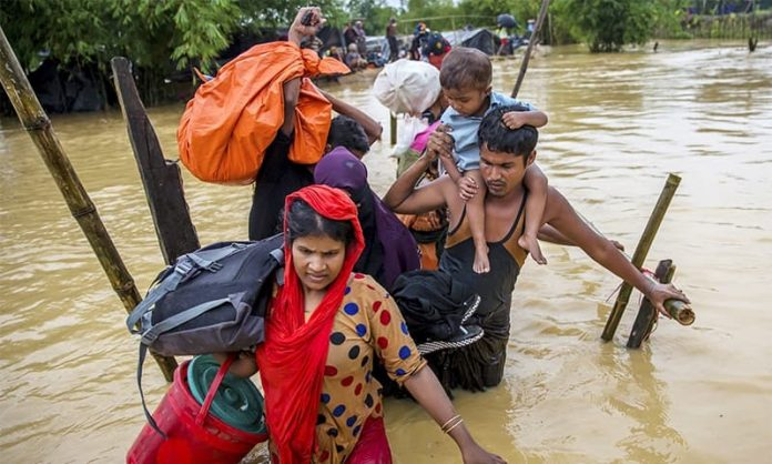 rohingya-muslims-move-camp-camp-amid-rain-mud-slides-extortion