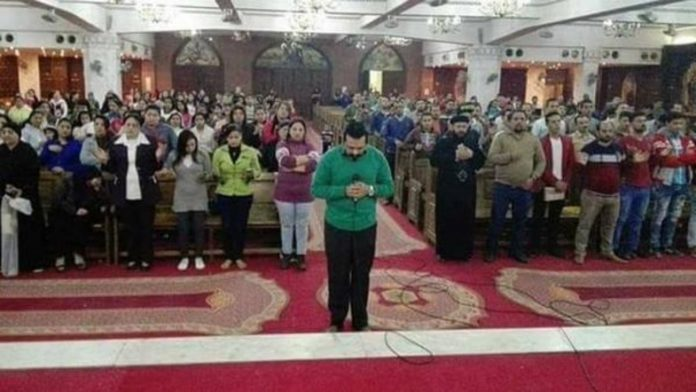 egyptian-copts-pray-victims-mosque-attack-emotional-photo